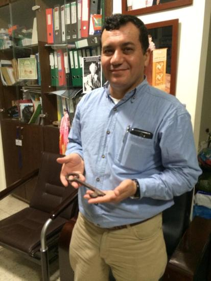 Dr. Abdelfattah Abusrour with the key to his family's home (it is a well-known custom for Palestinian families to keep the keys to the homes they lost during the Nakba as a sign of their hope for return.