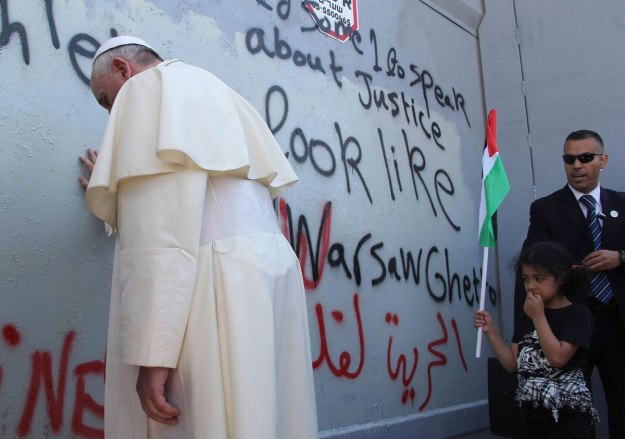 Pope Francis touches the wall that divides Israel from the West Bank in the West Bank city of Bethlehem